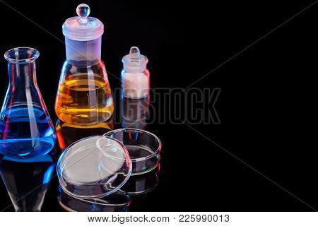 The Chemistry Lab Background. Various Glass Chemistry Lab Equipment On Black With Copy Space