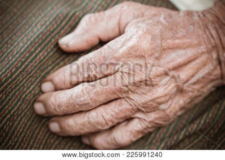 Hands Asian Elderly Woman Grasps Her Hand On Lap, Pair Of Elderly Wrinkled Hands And Traces Of Hard