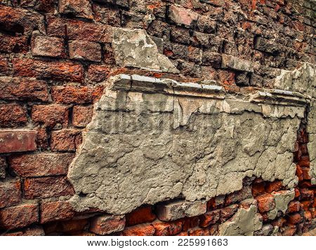 Ruins With Remains Of Stucco On Old Brick Wall