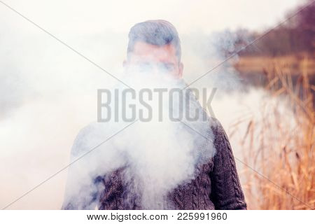 Portrait Of Man Hiding In The Fog In Front Of Lake