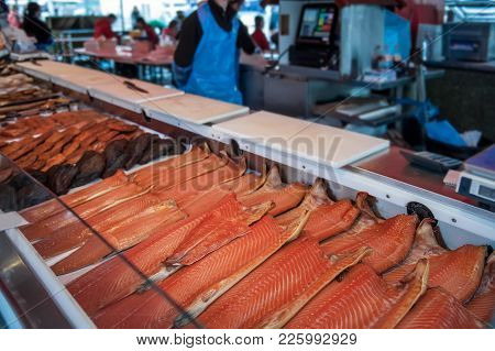Large Showcase With Halves Of Delicious Fish Of The North Sea Trout, Salmon, Pink Salmon On The Coun