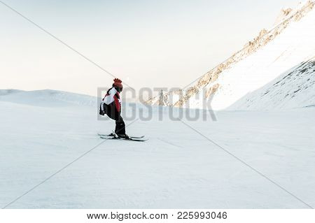 Teenager Learning How To Ski In The Blue Sky