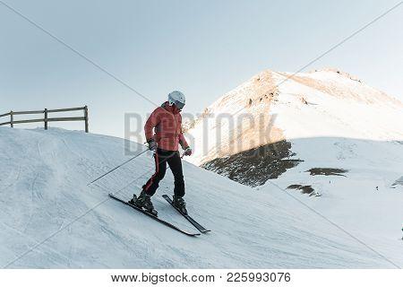 Man Skier Riding By Snowy Piste