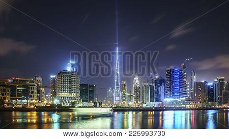 Dubai,uae - January 07,2018: Downtown Summer Night Skyline. Panoramic View Of Business Bay And Downt