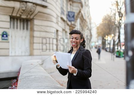 Doctor Of Economic Sciences Worked Very Hard And Defended Thesis. Pretty Young Woman With Papers In