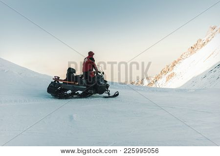 Man Lifeguard Snowmobile Rides In The Mountains. Medical Worker, Health Worker, Health Professional,