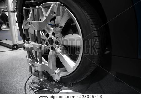 Tyre Balancing Of Modern Car In Workshop Closeup Photo