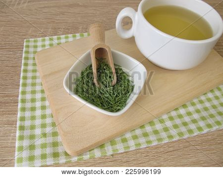 Cup of herbal tea with dried common horsetail