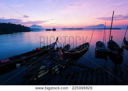 Longtail Boat With Coastal Fishing Village ,beautiful Scenery Morning Sunrise Over Sea And Mountain