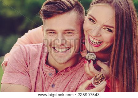 Love And Happiness. Cute Lovely Lovers Feeding Each Other By Cupcakes Cookies. Smiling Couple With S