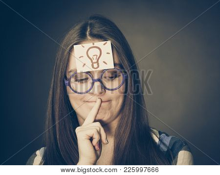 Woman Confused Thinking Seeks A Solution, Paper Card With Light Idea Bulb On Her Head. Student Girl