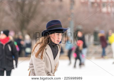 Stockholm, Sweden - February 3, 2018: Side View Portrait Of A Woman Wearing Hat And Coat Skating At