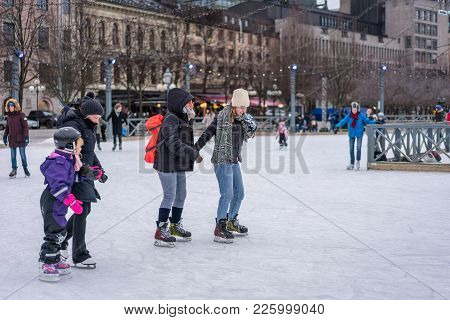 Stockholm, Sweden - February 3, 2018: Side View Of Two Woman Skating At A Public Ice Skating Rink Ou