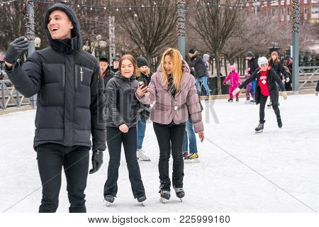 Stockholm, Sweden - February 3, 2018: Front View Of Three Happy Young People, Woman And Man. Using M