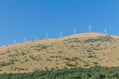 Horizontal-axis wind turbine towers station in Abruzzo, Italy poster