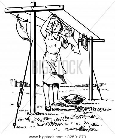 Woman hanging the linen