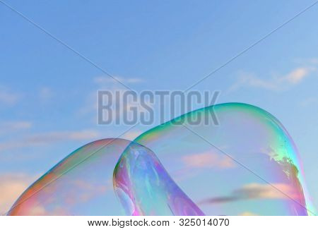 Fragment Of Large Beautiful  Bubbles Against Sky At Sunset. Metaphor For Something Attractive But Ep