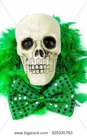 Bony Skull Wearing A Green Sparkly Bowtie Over White
