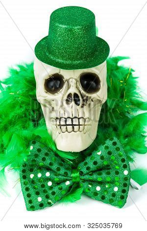 Bony Skull Wearing A Green Sparkly Hat And Bowtie Over White
