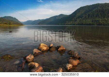 Vertical photoof Teletskoye lake in Altai mountains, Siberia, Russia. Beauty summer morning.