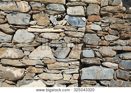 Old stone wall texture rough edges