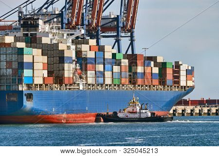 Huge container ship in port being loaded