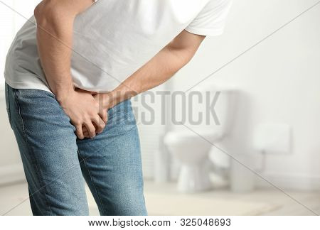 Man Suffering From Pain Indoors, Space For Text. Urology Problems