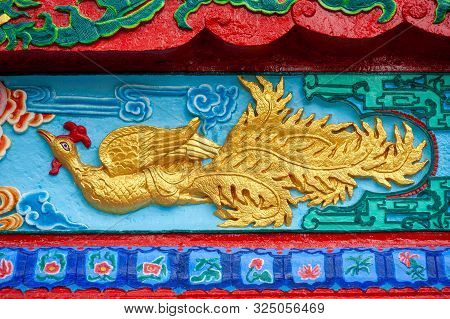 Fenghuang Chinese Phoenix Bas-relief In A Taoist Temple In Qingchengshan, Sichuan Province, China