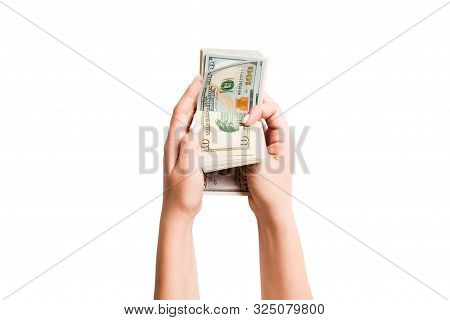 Isolated Image Of Female Hands Counting Dollars On White Background. Top View Of Salary And Wages Co