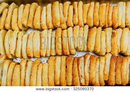 An Upper View Of Just Baked Brown Puff Pastry Buns