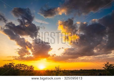 Sunset In Meadow Nature Landscape. Meadow Landscape In Sunset. Nature Landscape. Sunset In Meadow La