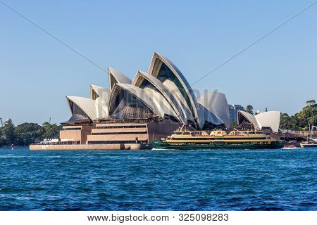 Sydney, Australia - March 27th 2013: The Manly Ferry Sails Past The Opera House. The Ferries Run Fro