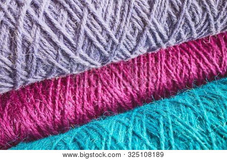Abstract Background Made Of Colorful Worsted.