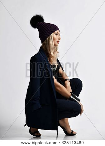 Glamorous Woman Blonde In Velvet Plush Bralet, Blue Jacket, Pants, High Heels Shoes And Knitted Wint