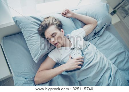 Top High Above Angle Photo Of Overworked Blonde Haired Man Lying On Bed Sleep Ignore Alarm Clock Rin