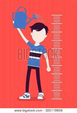 Boy At Child Height Growth Chart With Watering Can. Schoolboy Pouring Water Over His Head To Grow Bi