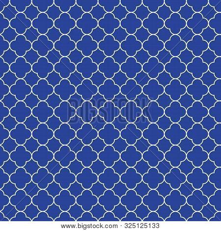 Elegant Classic Quatrefoil Elements On A Striking Blue Background.