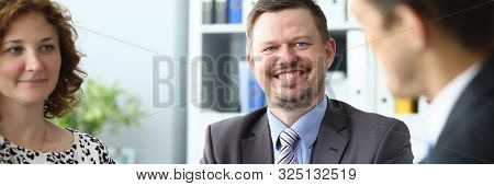 Portrait Of Smiling Bearded Man Clapping Hands And Attractive Businesswoman Handshaking With Biz Par