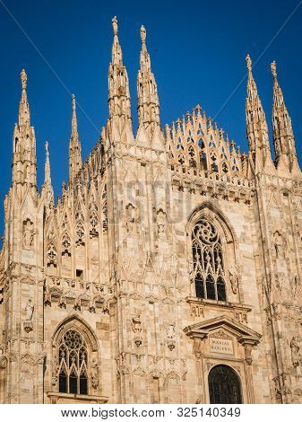 Ornate Facade Of Milan Catehdral In Italy At Sunset