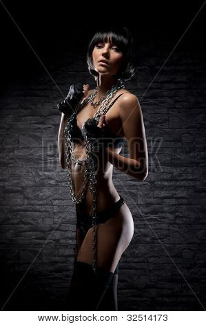Fashion shoot of young bizarre woman in fetish dress poster