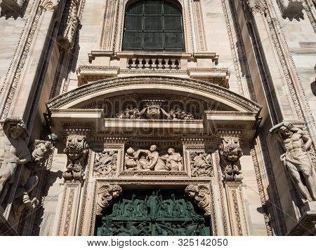 Ornate Facade Of Milan Catehdral In Italy