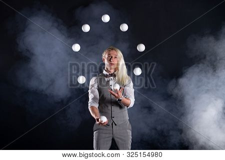 Juggler Wearing A Suit Like A Businessman Throwing White Balls. Concept Of Success And Management