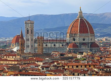 Cathedral And Giotto Bell Tower Of Florence In Tuscany Region In Italy With Vivid Colors