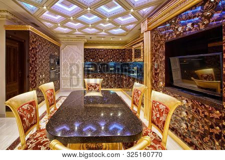 Interior Of The Living Room In A Modern Luxury House.large Dining Table In The Interior Of The Apart