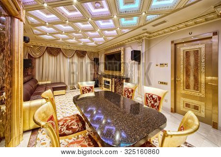 Interior Of The Living Room In A Modern Luxury House. Large Dining Table In The Interior Of The Apar