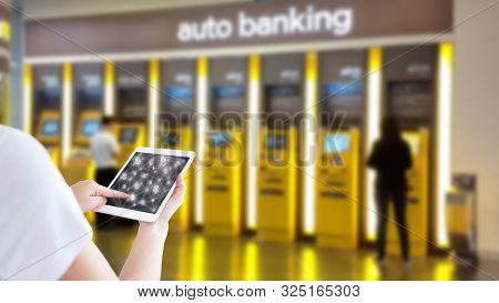 Businesswoman Use Digital Tablet On Atm  Background