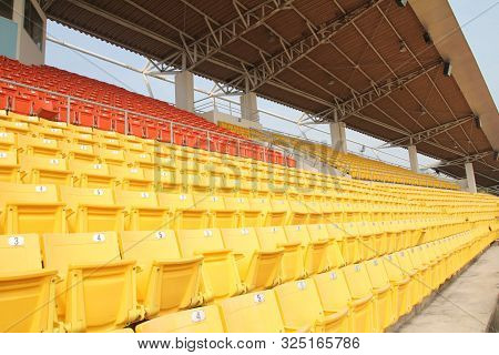 Bright Yellow And Red Stadium Seats On The Stadium Sport