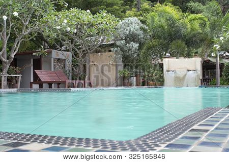 Beautiful Tropical Resort Swimming Pool With Vibrant Turquoise Water,