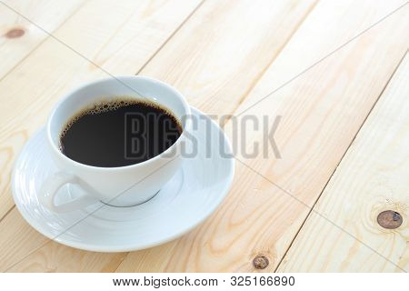Black Coffee Cup On Wood Table Background