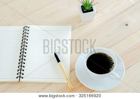 Open Notebook With Coffee Cup Table Wood